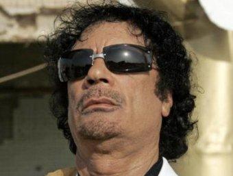 США заморозили  млрд на счетах Муаммара Каддафи