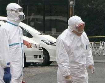 Япония повышает уровень опасности и думает о саркофаге