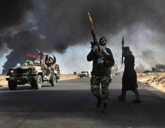 Армия Каддафи выбила повстанцев сразу из двух городов
