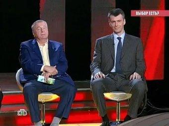 Жириновский на теледебатах НТВ подарил Прохорову часы Breguet