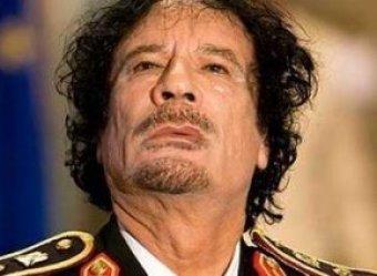 Повстанцы захватили Каддафи: ему прострелили ноги