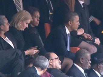 Британский премьер хочет заработать на фото с панихиды Манделы