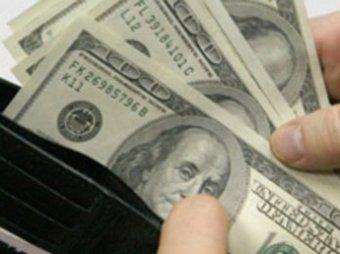 Доллар снова побил курсовой рекорд на фоне падения цен на нефть