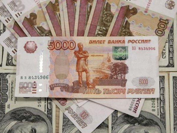 Курс доллара 16 сентября 2015 на торгах опустился ниже 66 рублей