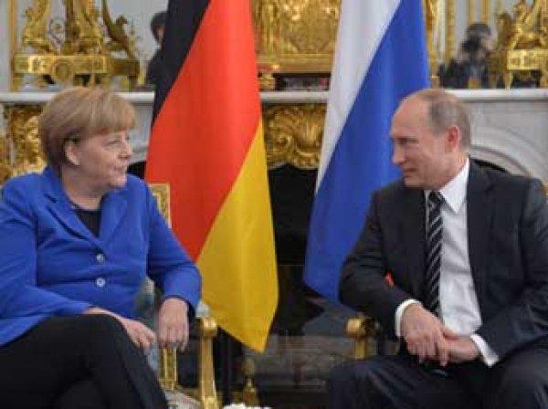 ИноСМИ назвали Меркель и Путина самым влиятельными людьми года