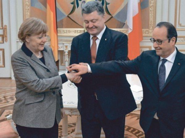 Олланд и Меркель прокомментировали итоги референдума в Нидерландах