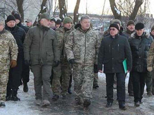 Охрана Порошенко пригрозила прострелить ноги журналистам