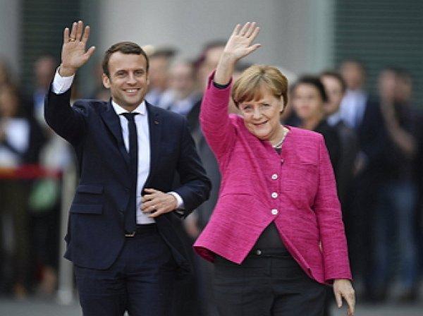 Макрон и Меркель пообещали России «решительный ответ»