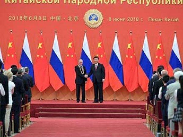 Путин стал первым в истории обладателем китайского ордена Дружбы