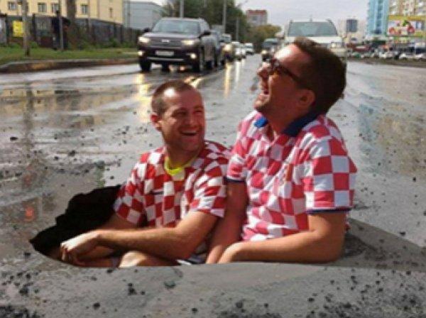 Хорватские болельщики вынудили дорожников заасфальтировать яму, снявшись в ней