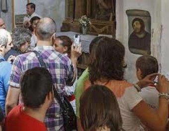 Испорченная горе-реставратором фреска принесла церкви 50 тысяч евро