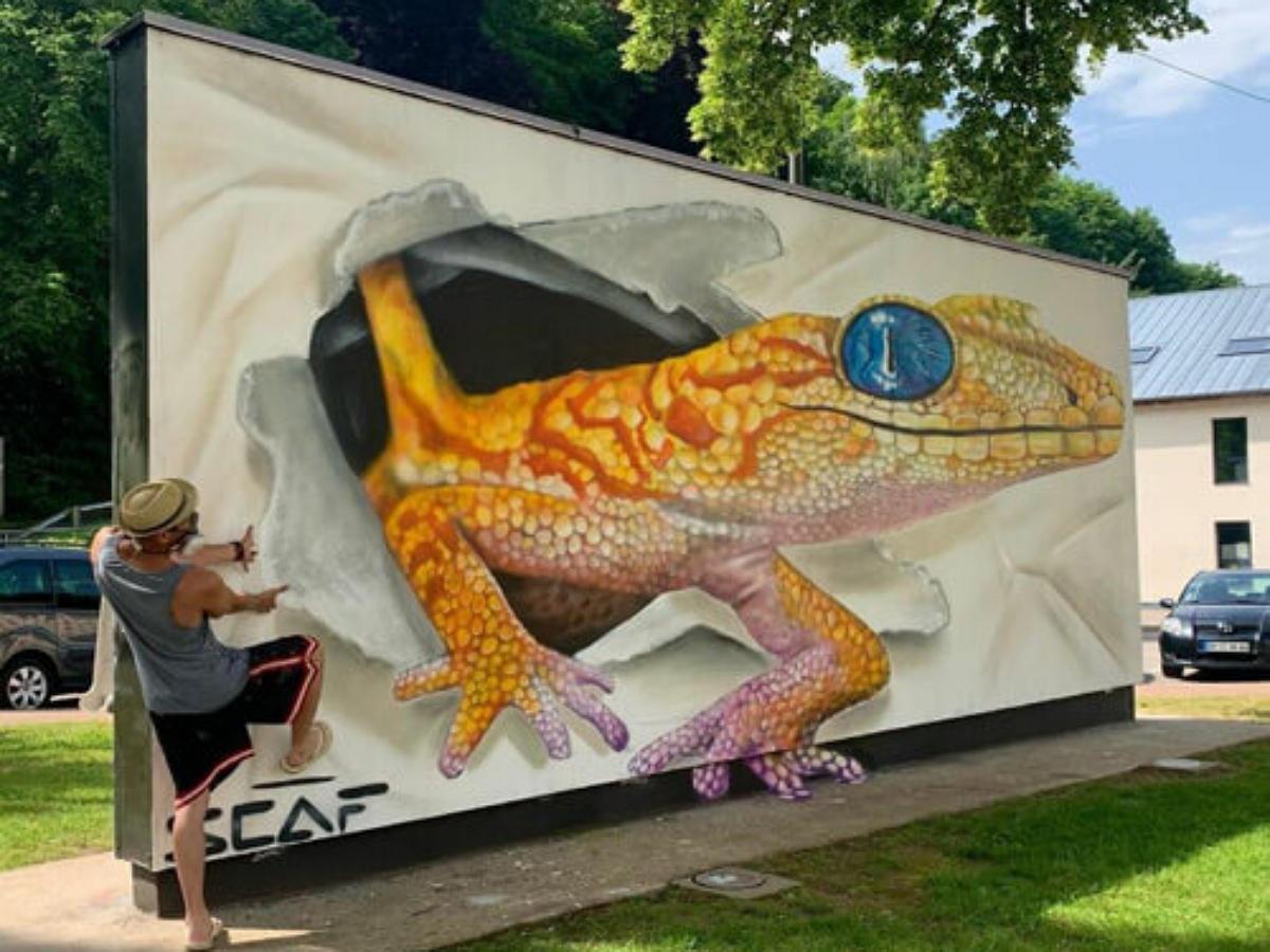 Уличный художник преображает серые улицы мегаполиса граффити с 3D-иллюзиями