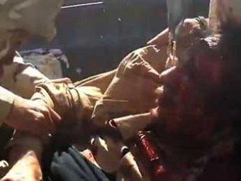 СМИ: повстанцы извращенно издевались над Каддафи перед его смертью