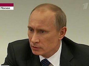 Путин осудил СМИ за публикацию кадров убийства Каддафи