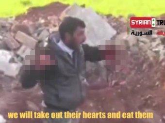 В Сирии повстанец перед телекамерой вырезал у солдата сердце и съел