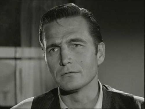 """Эрик Флеминг  Американский актёр, снимавшийся в кино и на телевидении в 1940-ых, 50-х и 60-х годах. В 1959 Эрик Флеминг снялся в роли босса Джила Фэвора в """"Сыромятной плети"""", одном из самом популярном телевизионном сериале."""